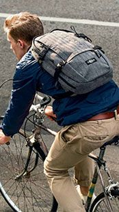Man riding a bike with Eastpak bag